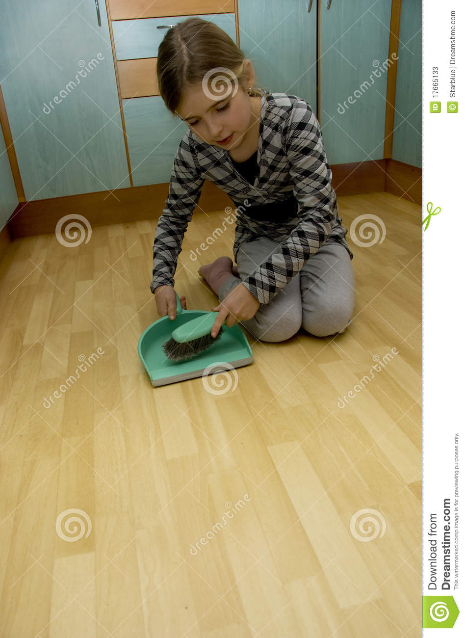 Girl cleaning ground