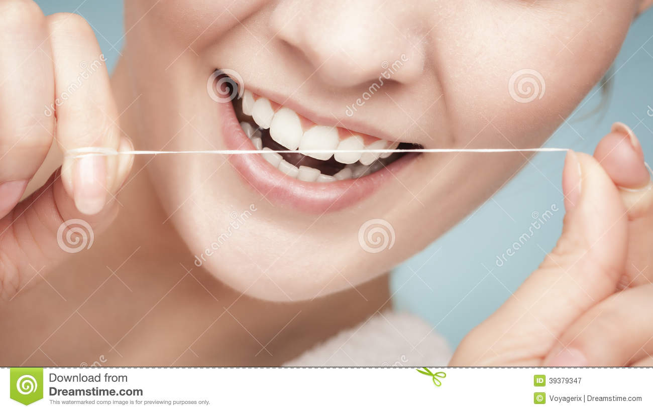 girl-cleaning-teeth-dental-floss-health-care-part-female-face-young-woman-smiling-her-white-blue-studio-shot-39379347.jpg