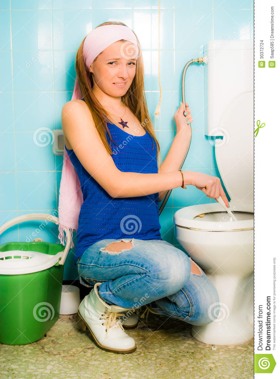 girl cleaning toilet seat stock photo image of female