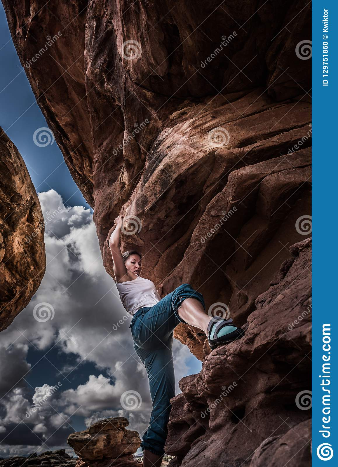 2e9827404f2 Girl Climber Practicing Bouldering On A Beautiful Red Rock In Ca ...