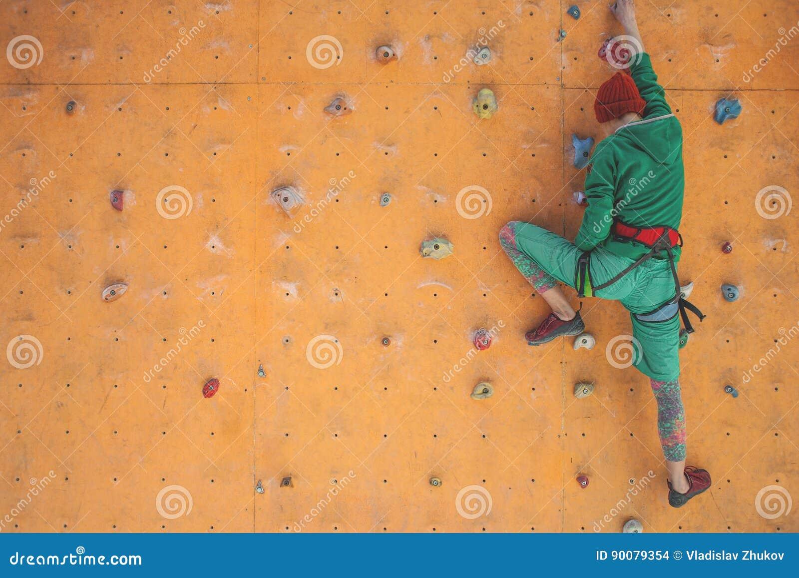 The Girl Climbs On The Climbing Wall. Stock Photo ...