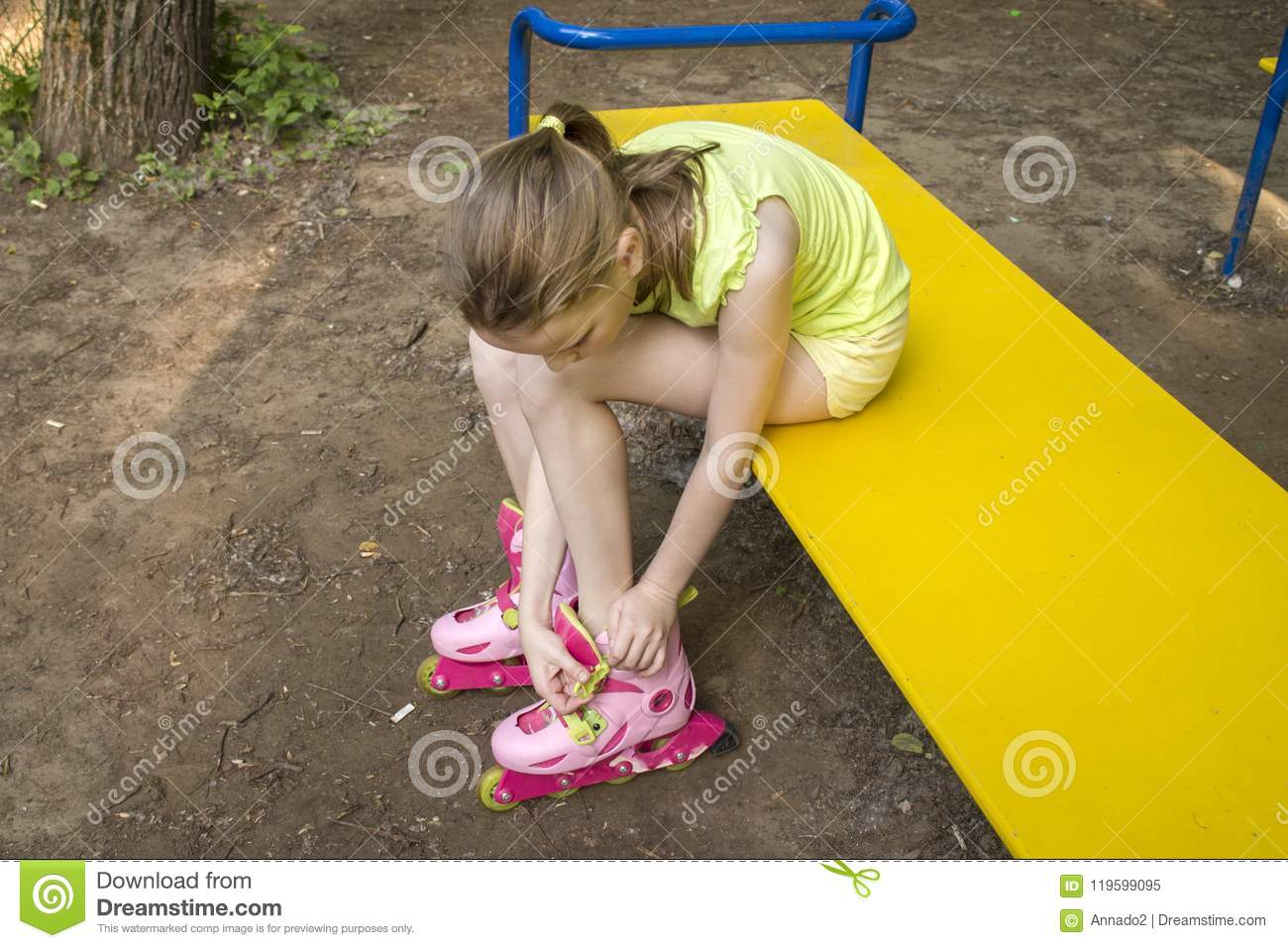 Girl clothes rollers sitting on a park bench