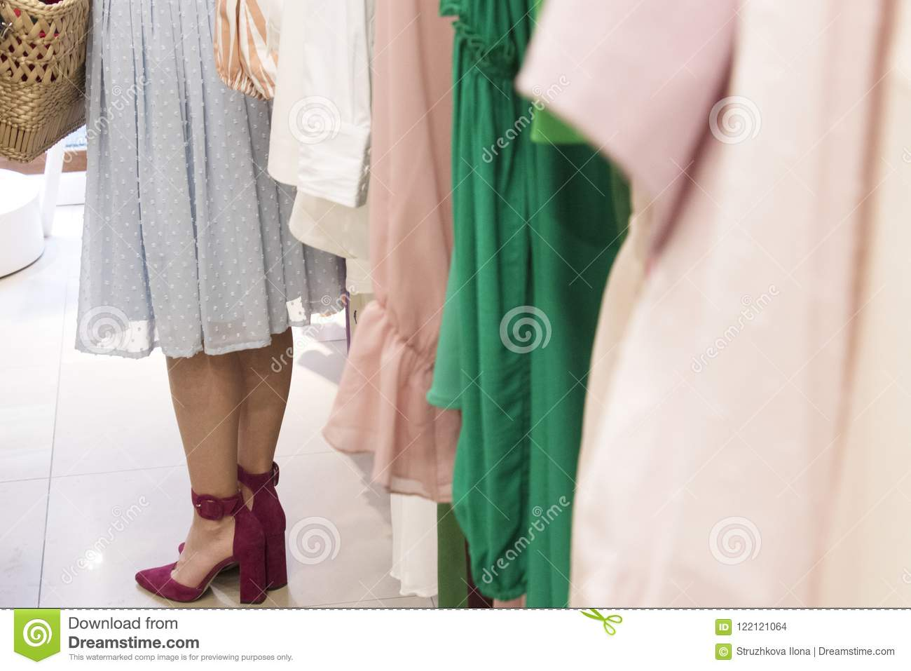 Girl in clothings the shop.