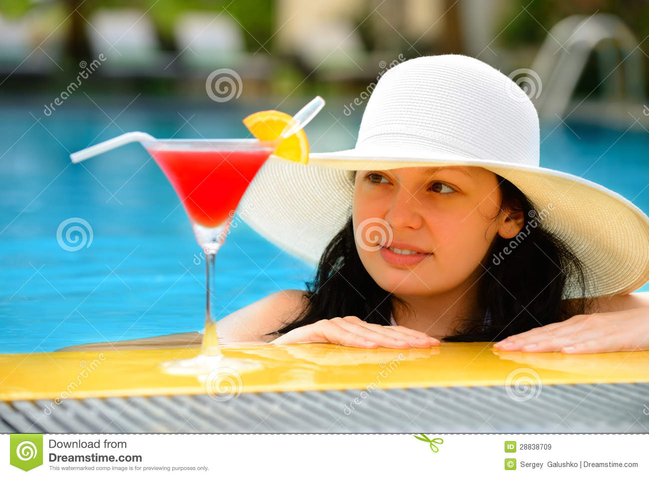 Girl With A Cocktail At The Edge Of The Swimming Pool Royalty Free Stock Images Image 28838709