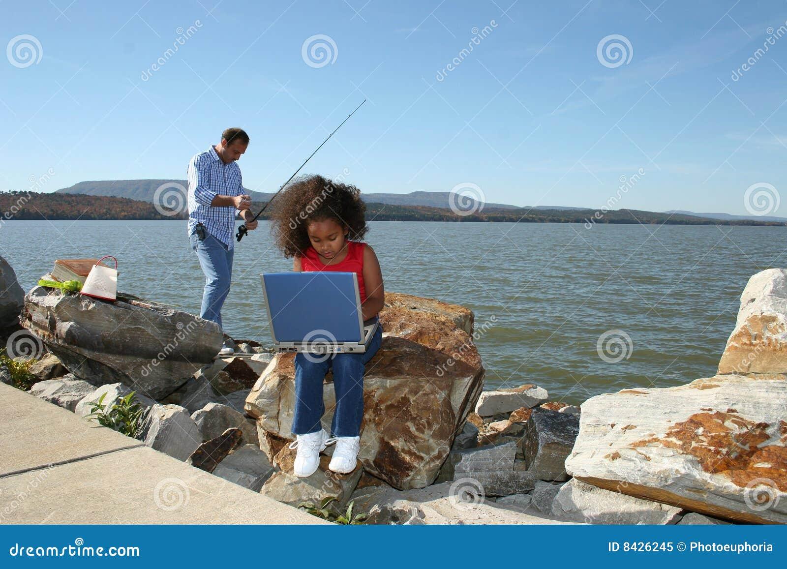 Girl on computer and fishing