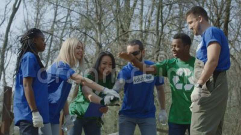 Girl Coordinating Group Of Volunteers Stock Video - Video of multiracial,  ecology: 115016607
