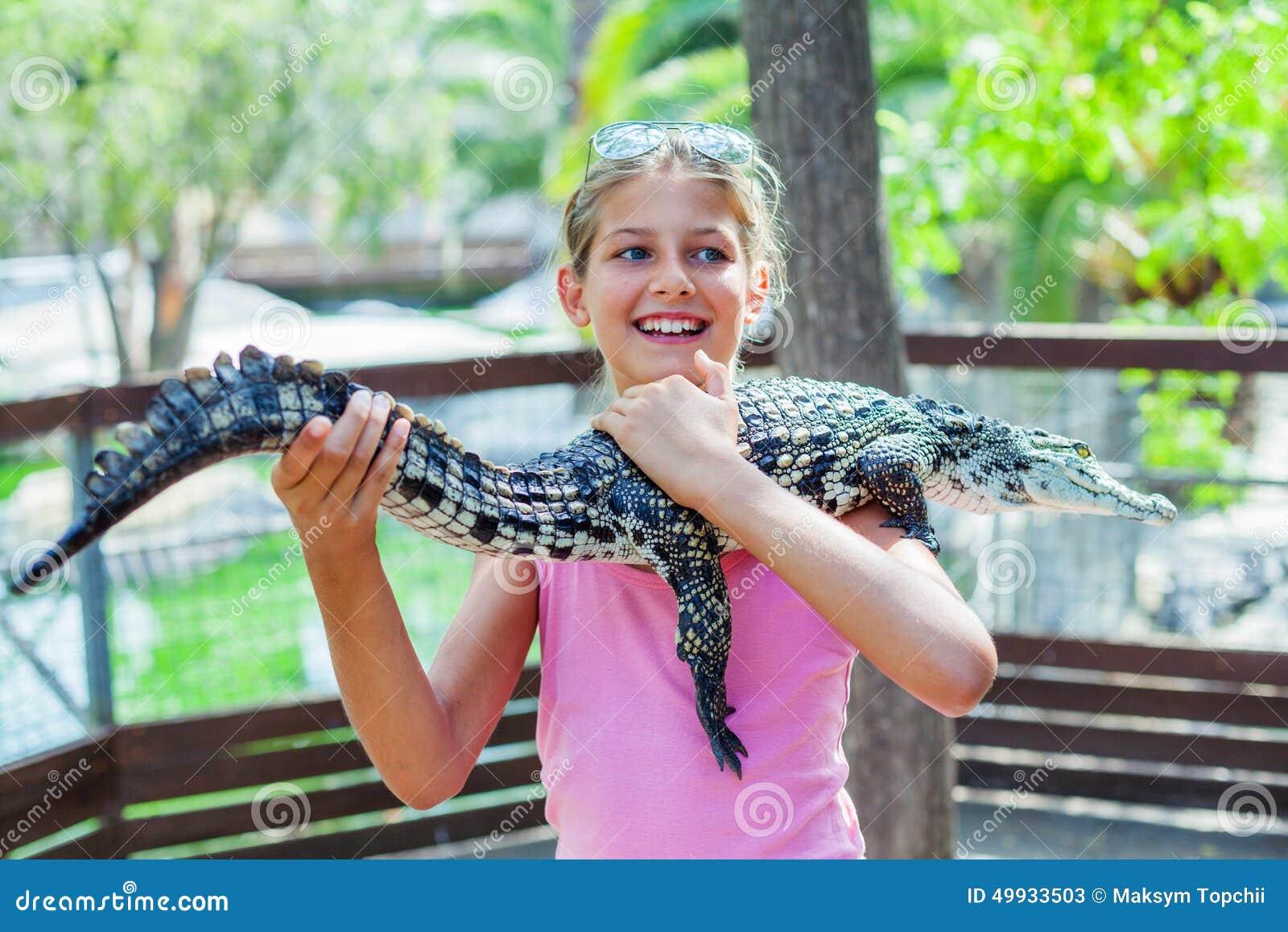 Girl With Crocodile Royalty Free Stock Photo