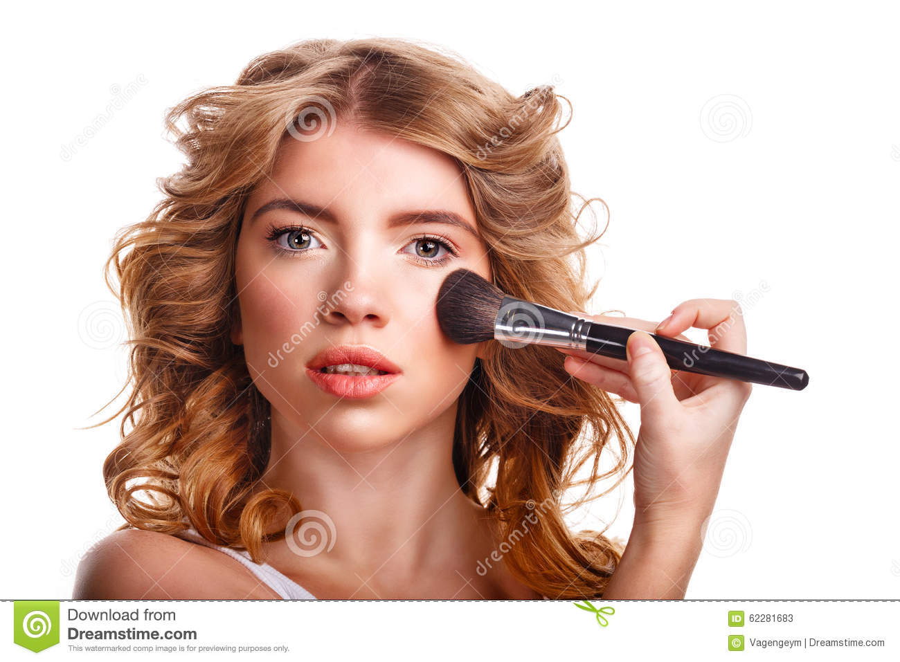 Girl with curly hair straightens makeup brush stock photo for Salon younga