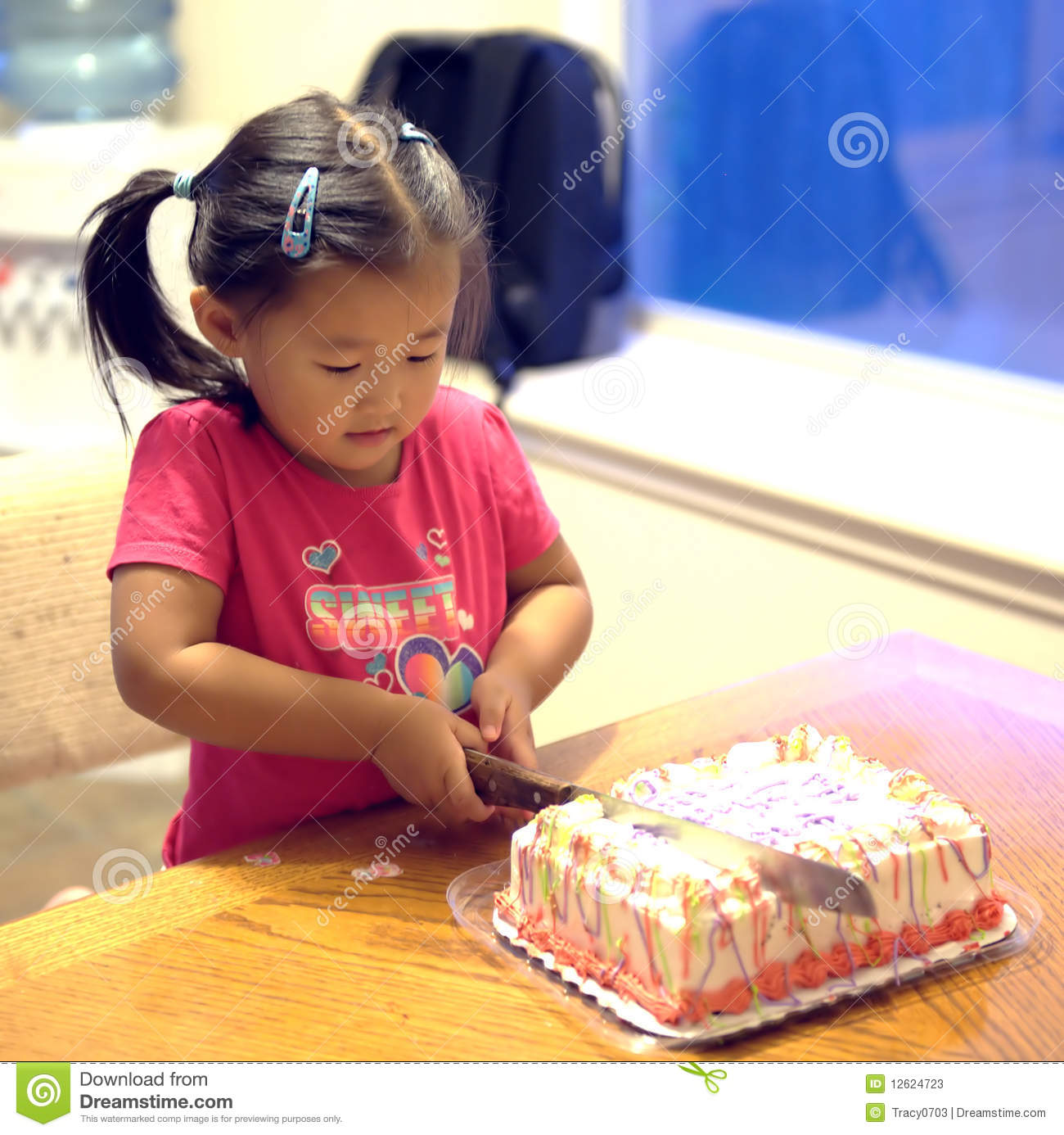 Girl Cutting Birthday Cake