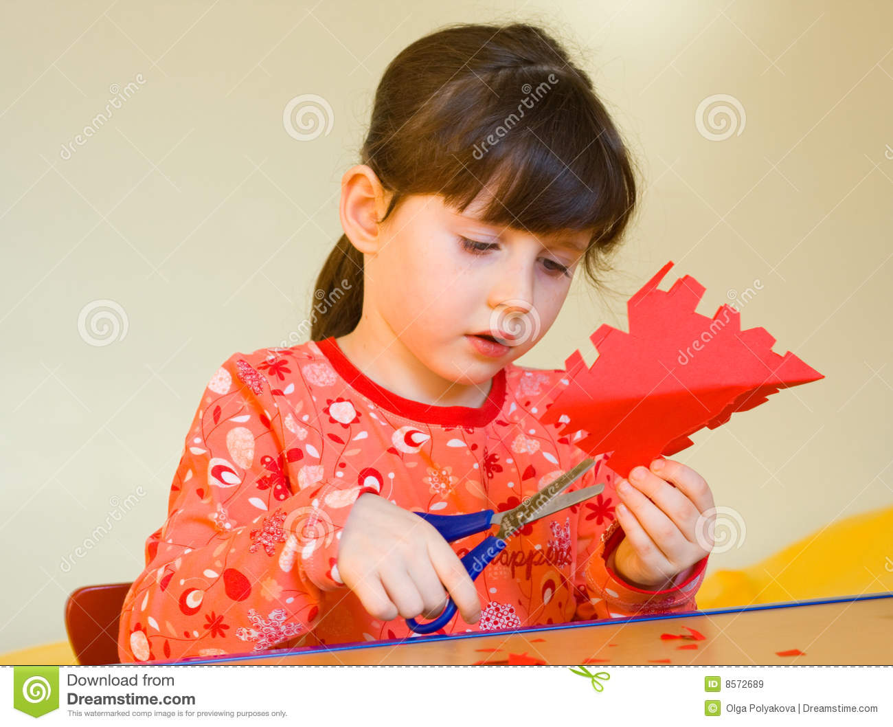 Girl Cutting Paper Roy...