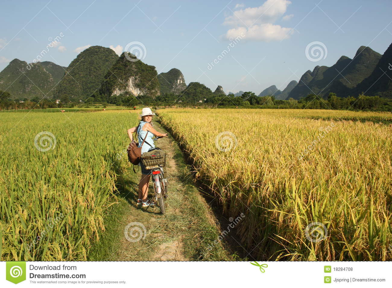 girl cycling in china country stock photo   image 18284708