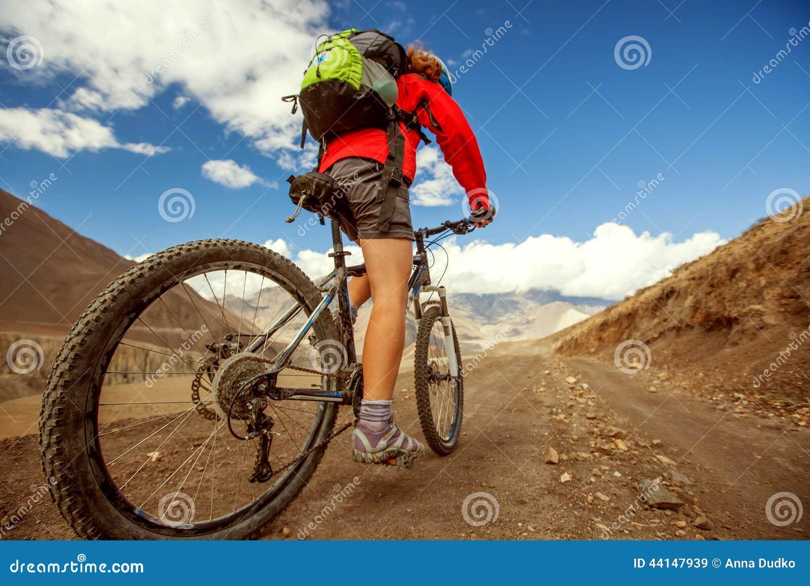 Girl cycling at the road