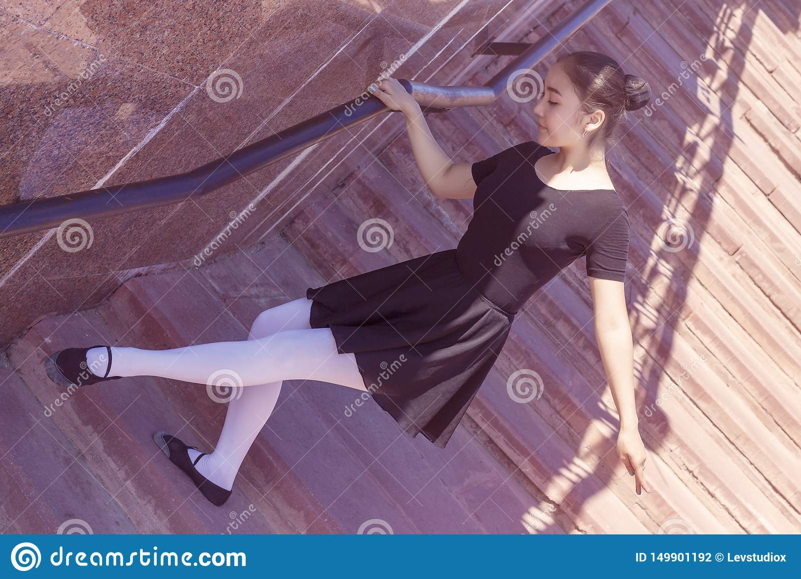 Girl dancer doing different movements of dance in bathing suit for dancing and ballet shoes