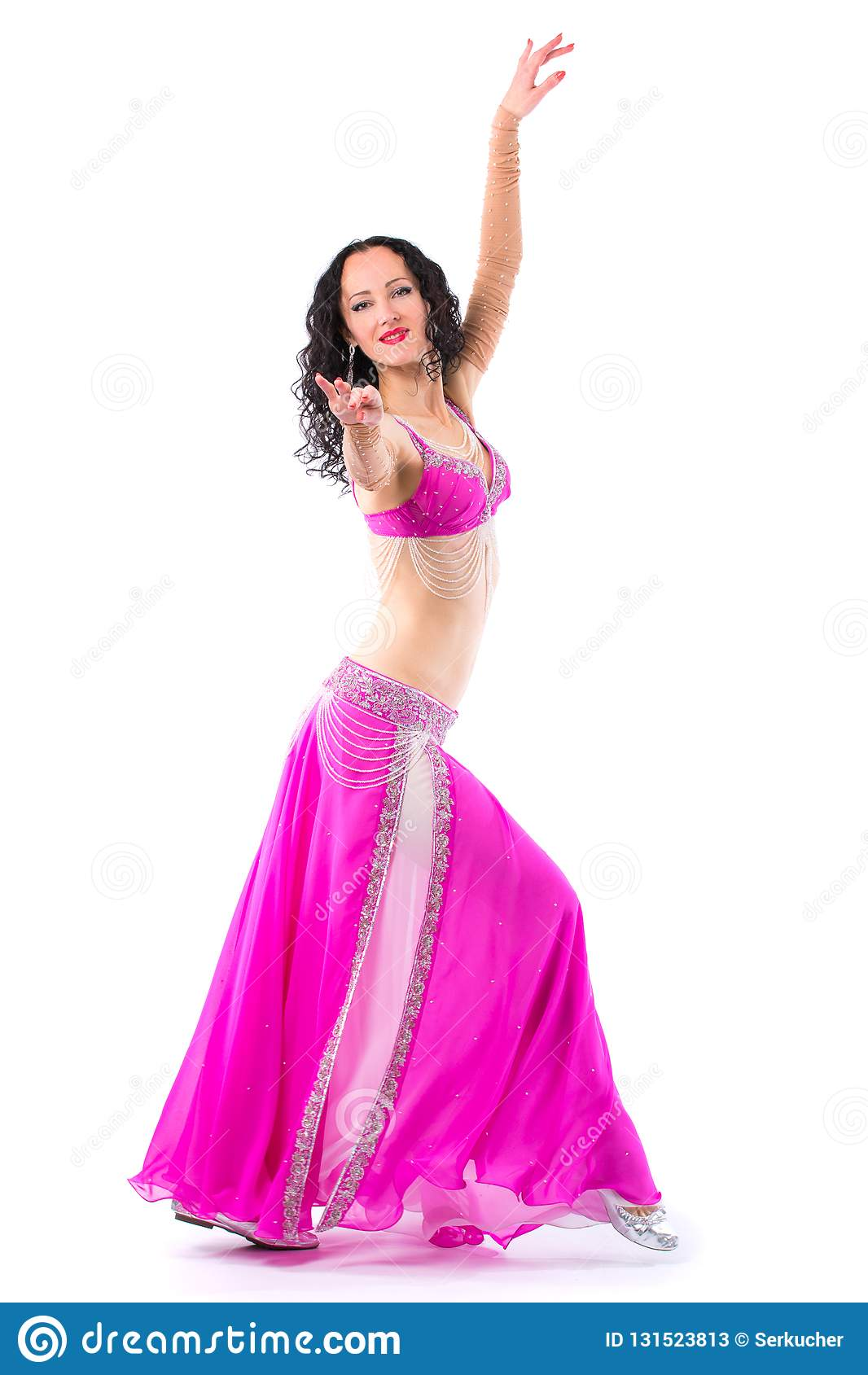 cb7a767ae girl dancing belly dance. The girl is froze in a dance position. Wonderful  brunette in the pink dress of an oriental dancer. Isolated on a white  background