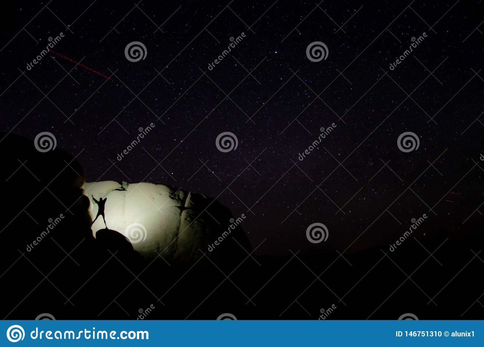Girl dancing on a rock at night