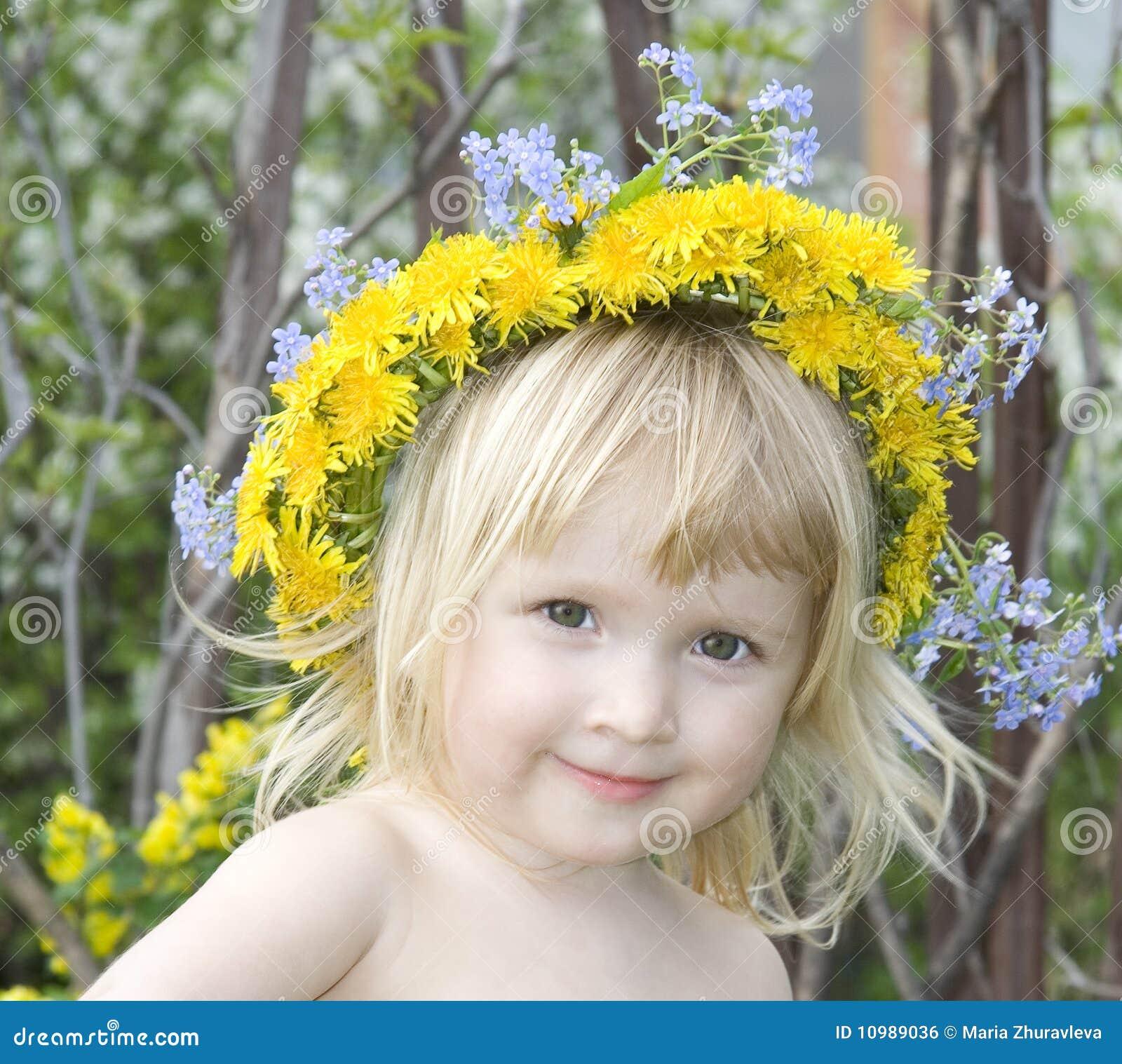 Girl with dandelion`s diadem
