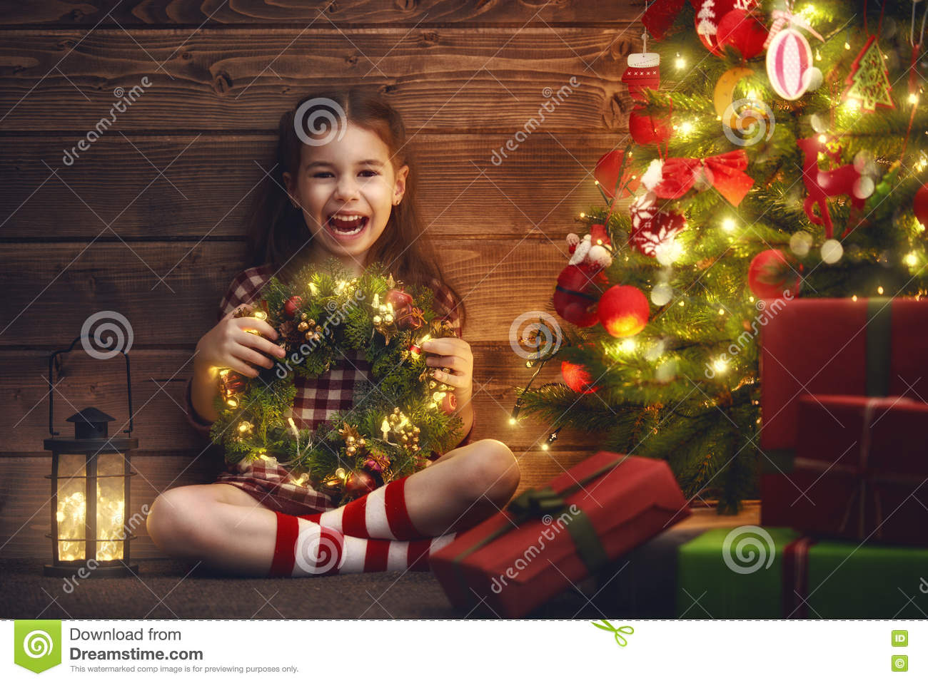 Girl Is Decorating The Christmas Tree Stock Photo