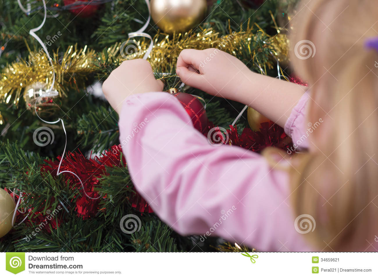 Girl Decorating The Christmas Tree,shot From Behind Stock