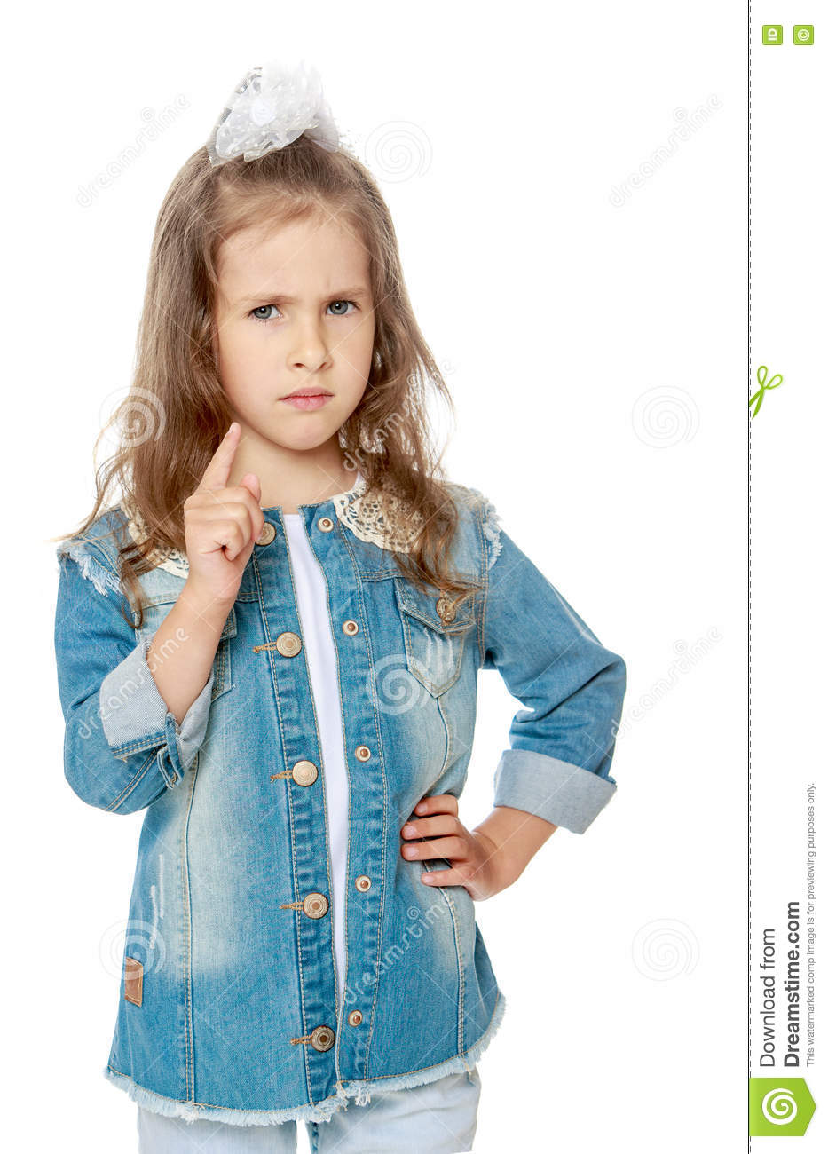 aefe202a3b9 Closeup of a serious little girl threatens with a finger - Isolated on white  background