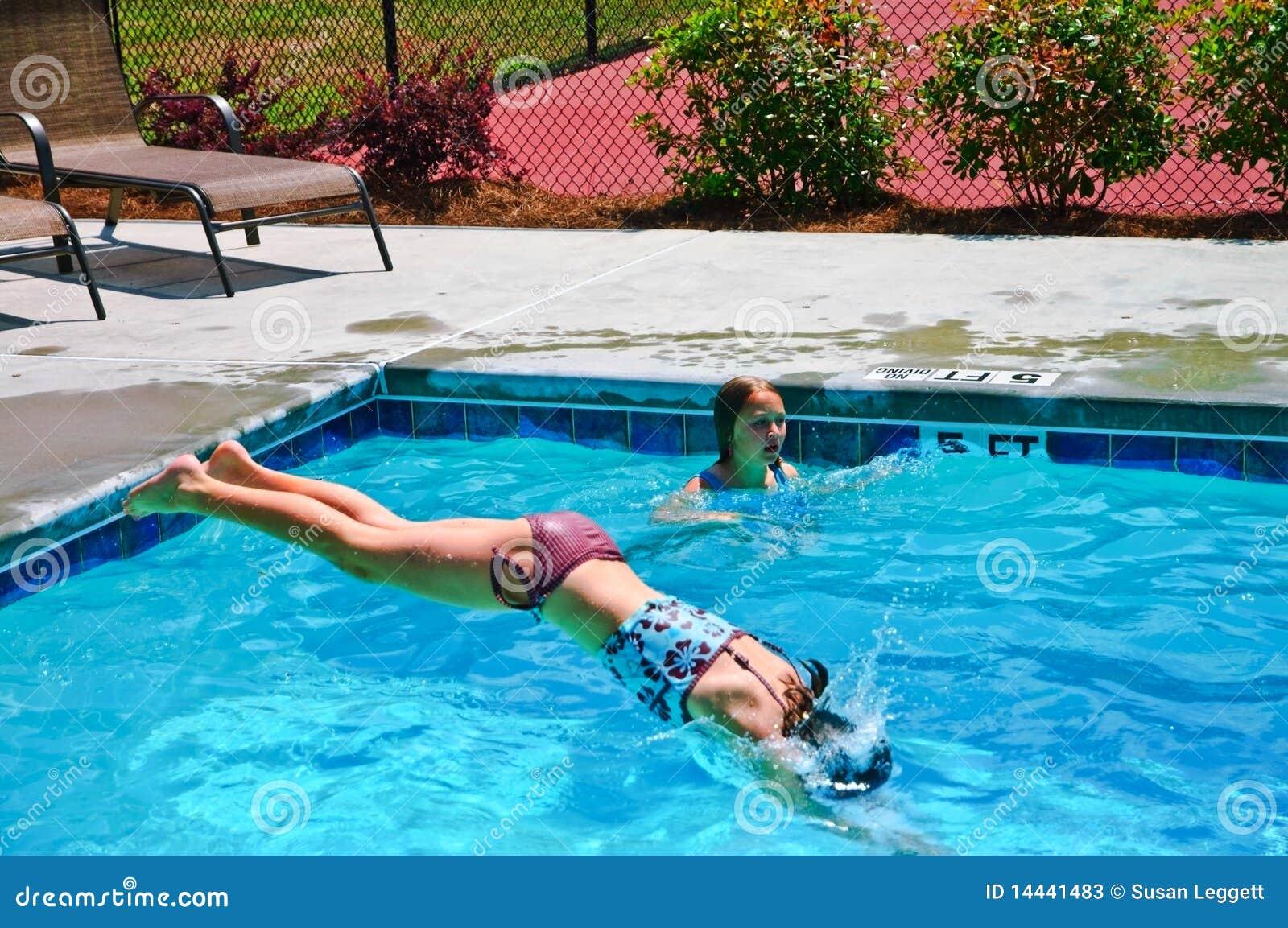 Girl Diving Into A Pool Stock Photos Image 14441483