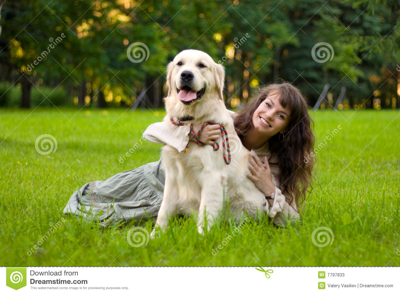 Girl with a dog on the grass