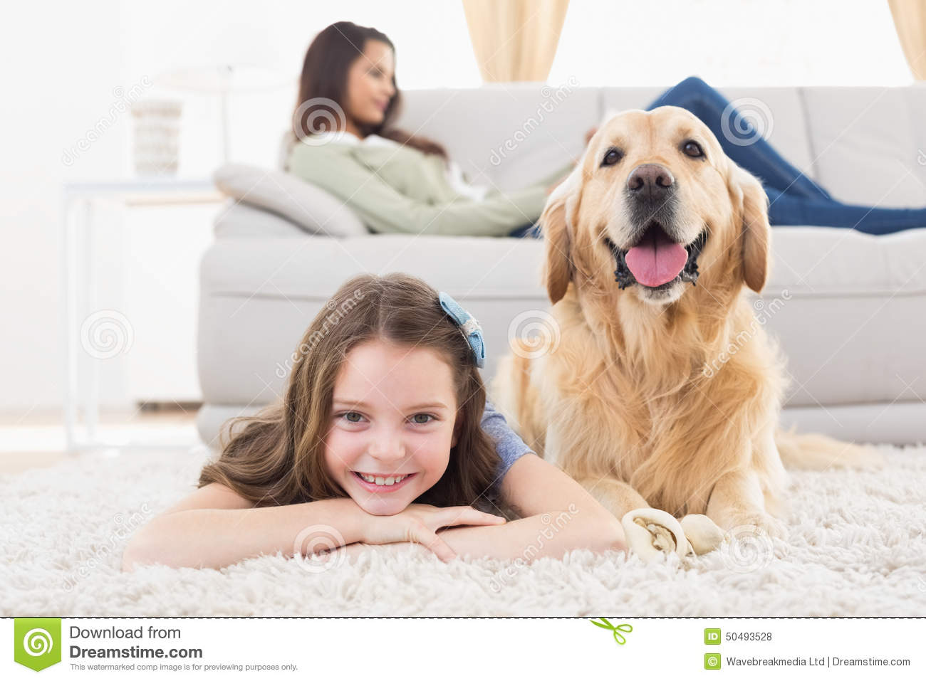 girl with dog lying on rug at home stock photo image 50493528. Black Bedroom Furniture Sets. Home Design Ideas
