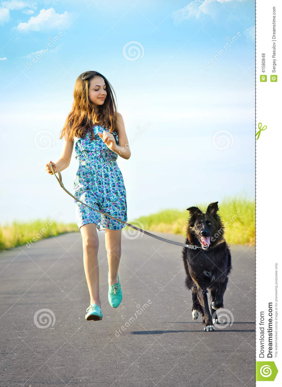 Girl With A Dog For A Walk Stock Photo Image 41580848