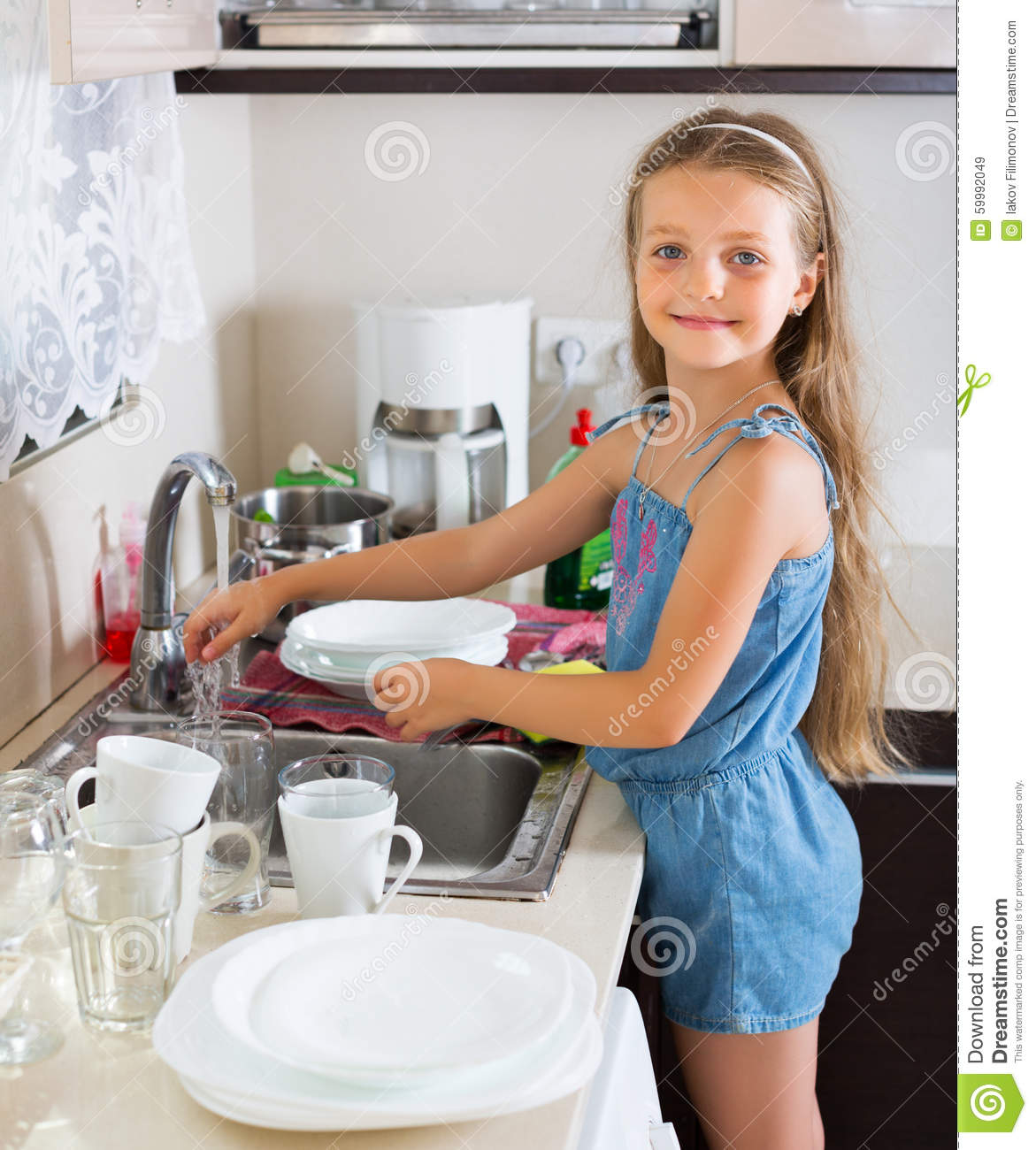Girl Doing Dishes At Kitchen Stock Photo