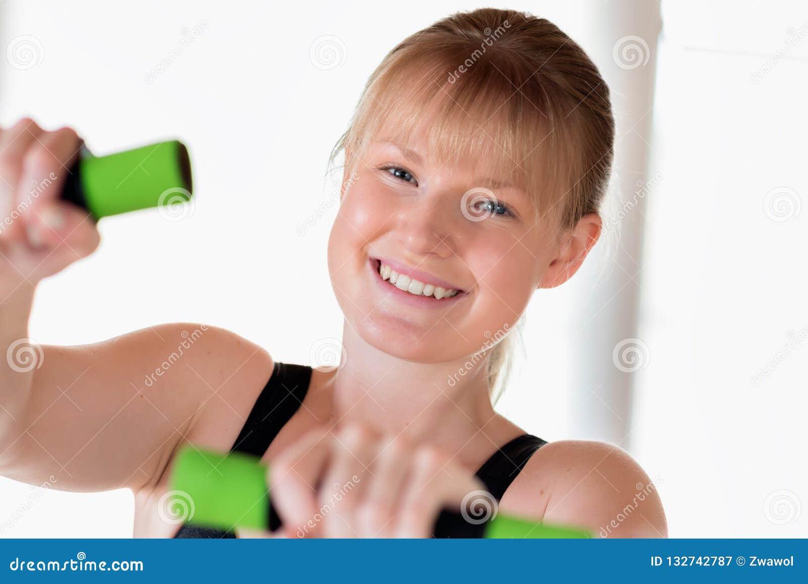 Girl Doing Dumbbell Exercises Stock Image - Image of