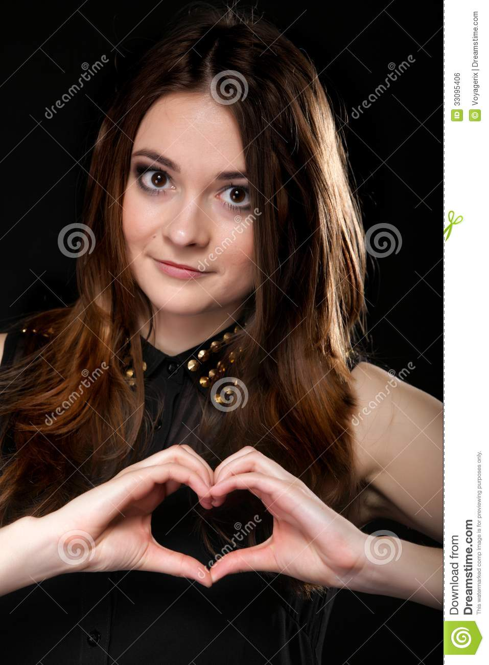 Girl doing heart shape love symbol with her hands.
