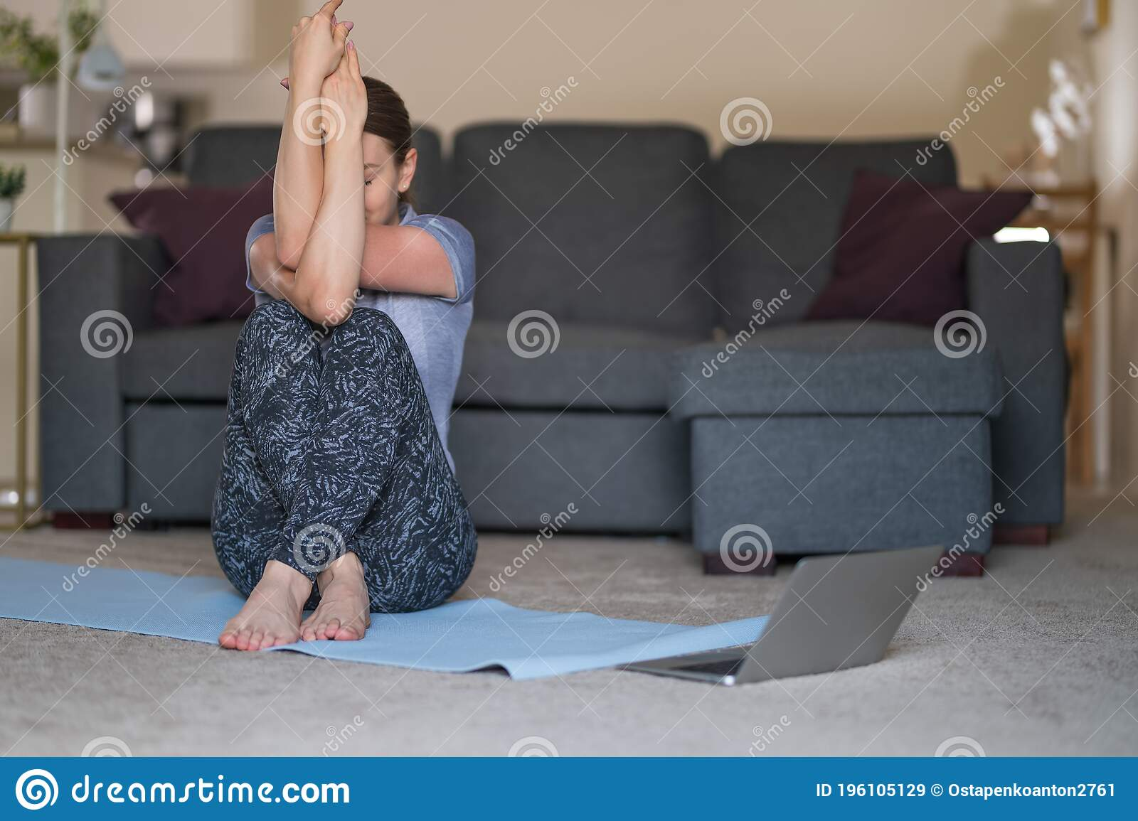 Girl Doing Yoga Exercises At Home Watching Videos On Laptop. Yoga ...