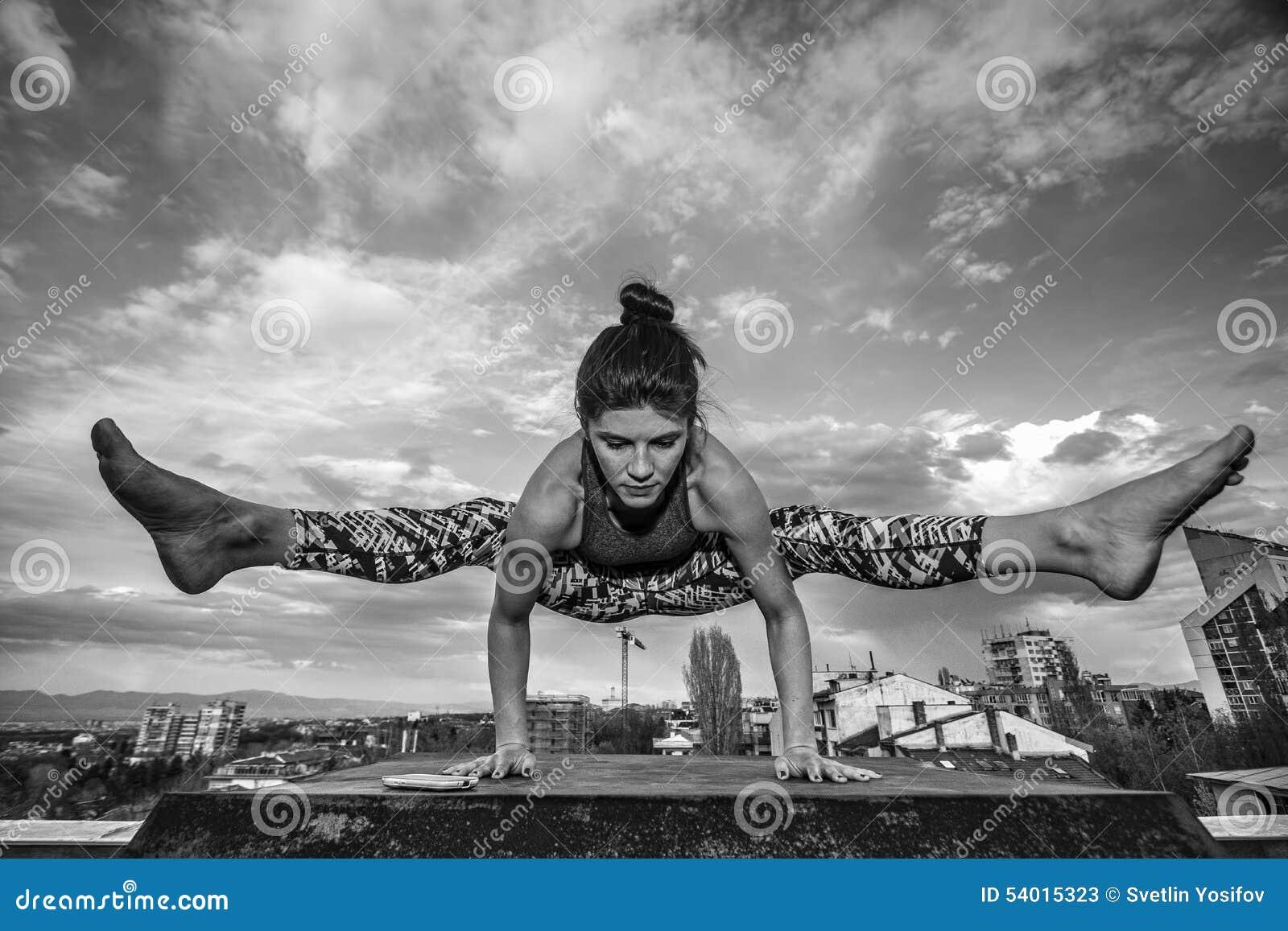 Girl doing yoga outdoors.