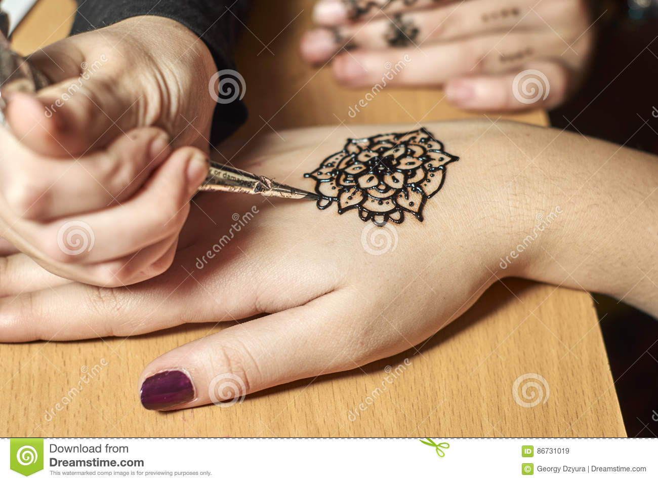 Girl Drawing Patterns By Henna On The Hands Stock Image Image Of