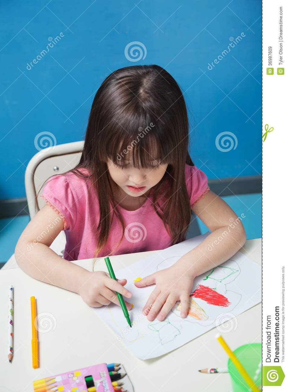 Classroom Design Sketch ~ Girl drawing with sketch pen in classroom royalty free