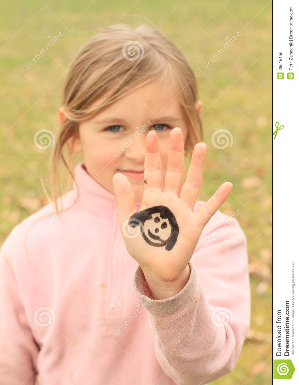 Girl with drawings on hand