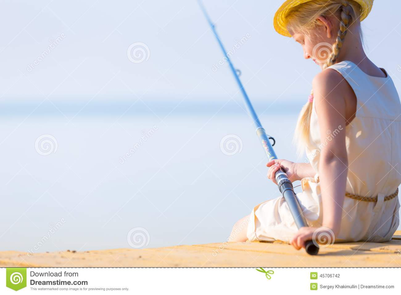 Girl in a dress and a hat with a fishing rod stock photo for Girl fishing pole
