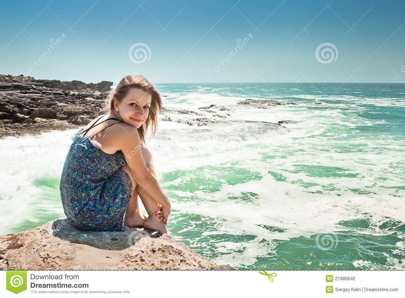 Girl sitting on rock woman with