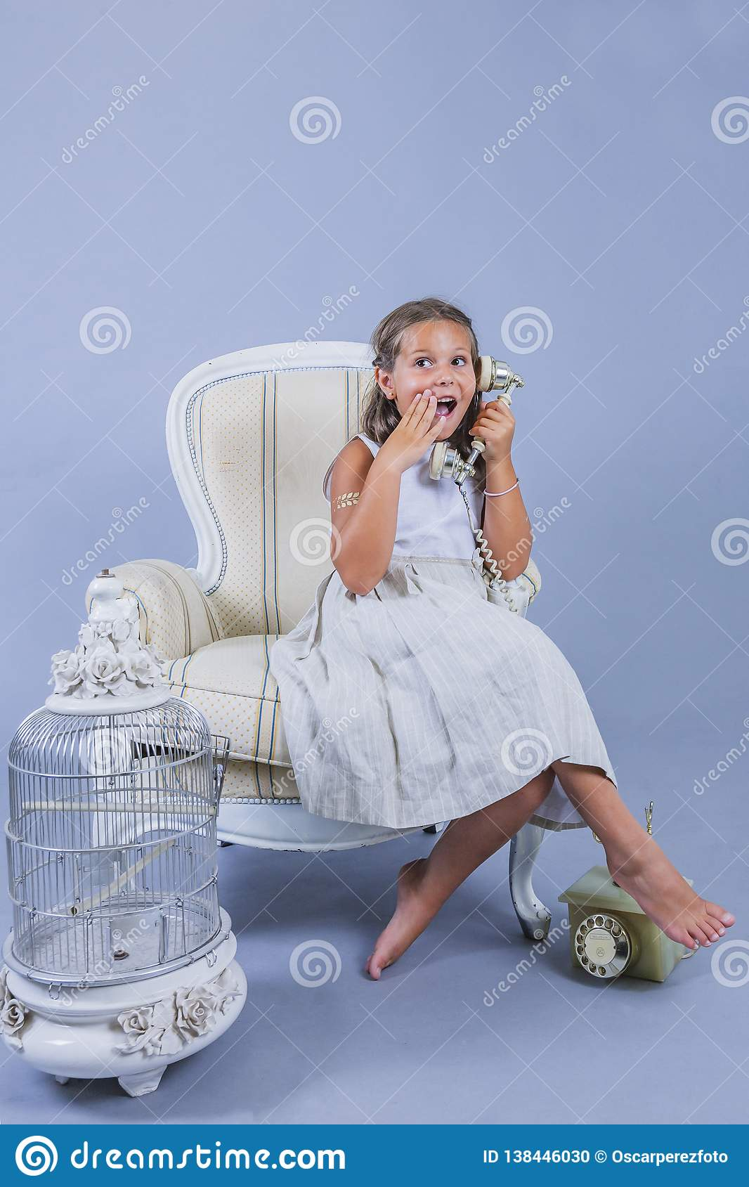 Girl in dress talking with old phone with surprised face