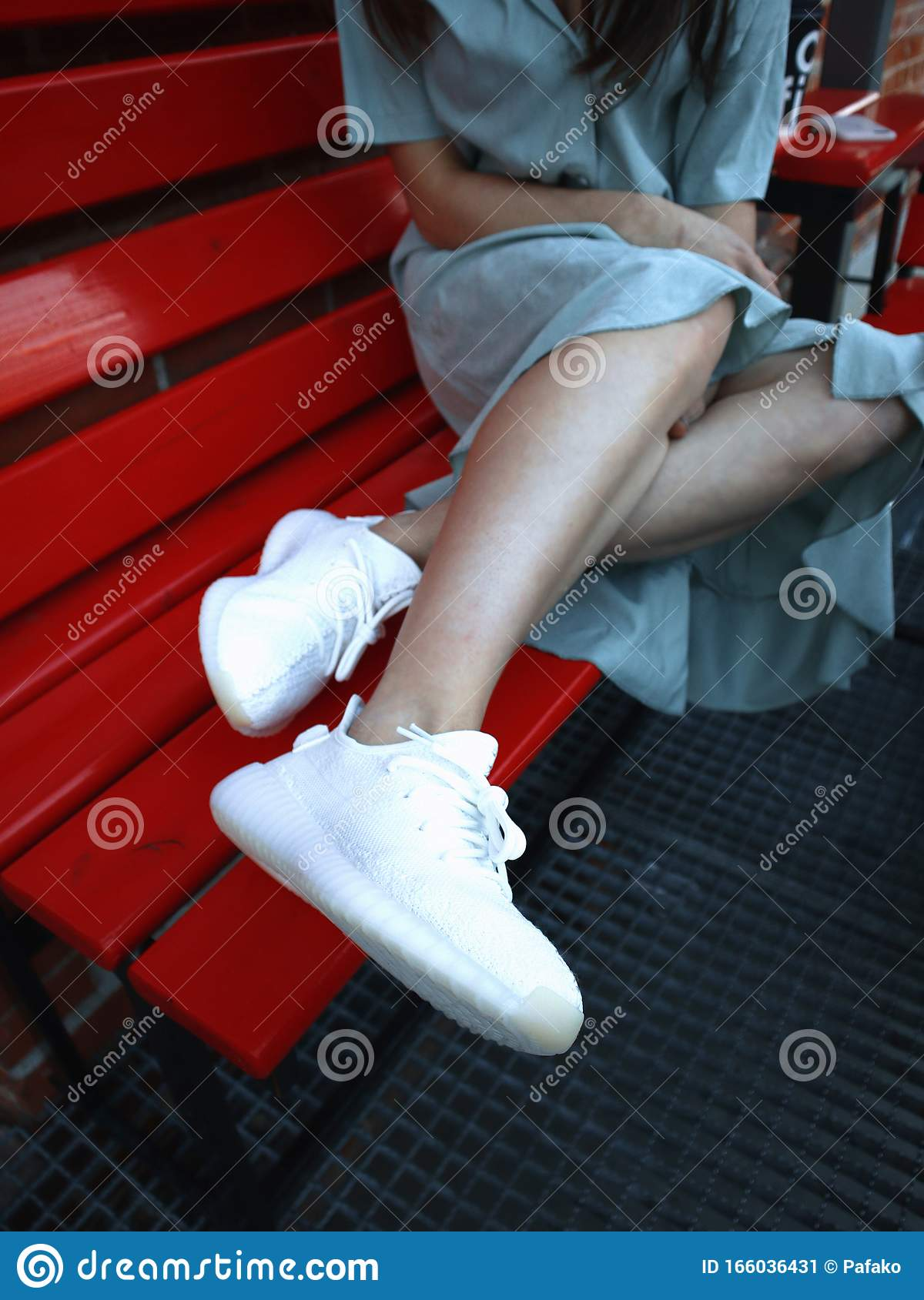 A Girl In Dress In White Adidas