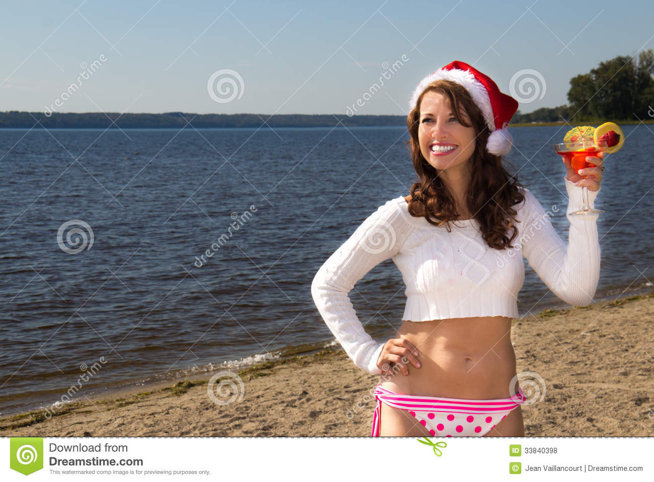 Model In Christmas Vacation.Girl With Drink On The Beach Christmas Vacation Stock Photo