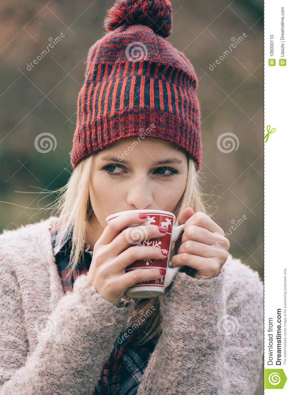 0d32e85776b Girl Drinking Hot Drink Outdoor. Coffee Or Drink In Mug. Stock Photo ...