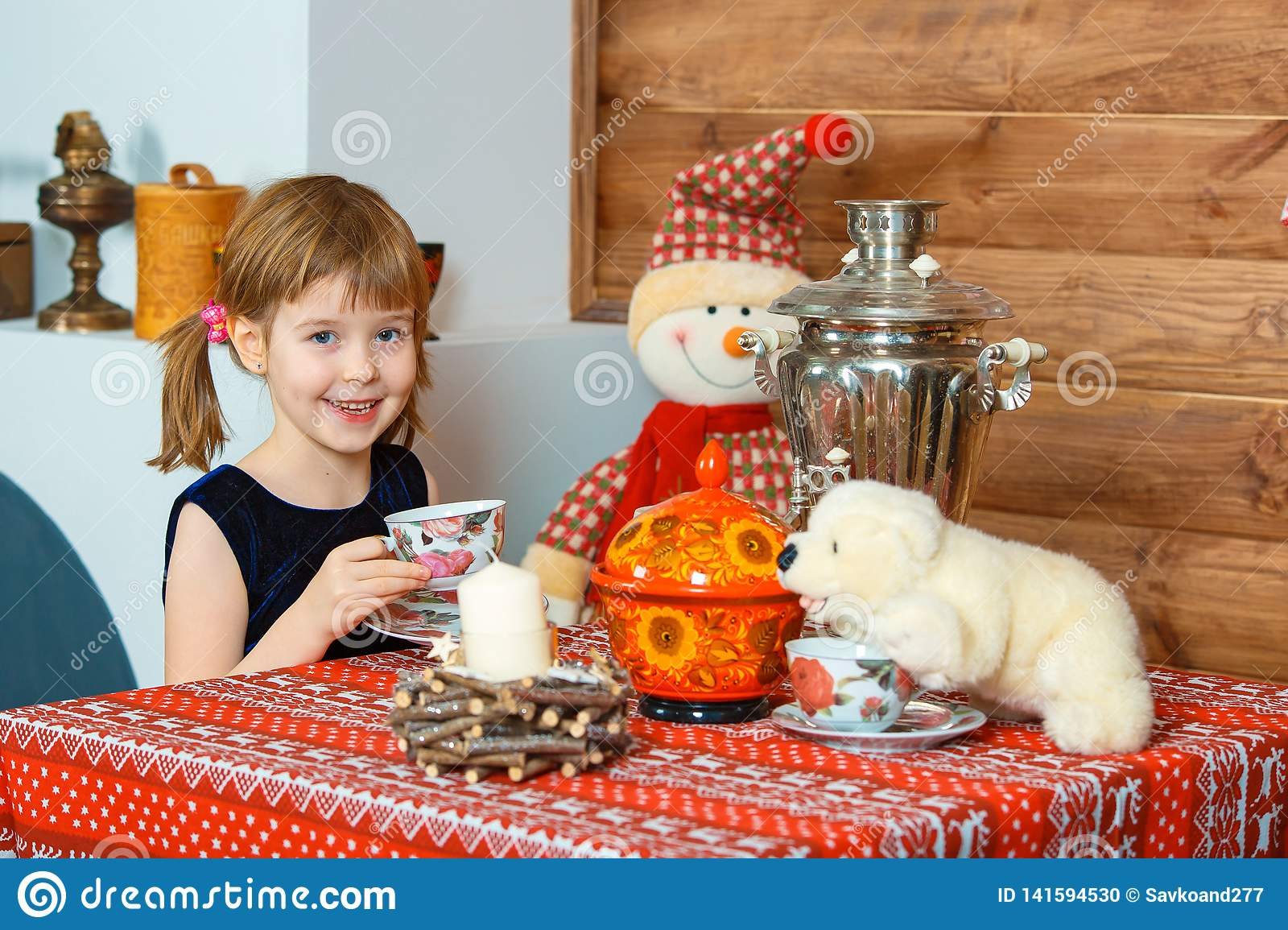 The girl is drinking tea and smiling
