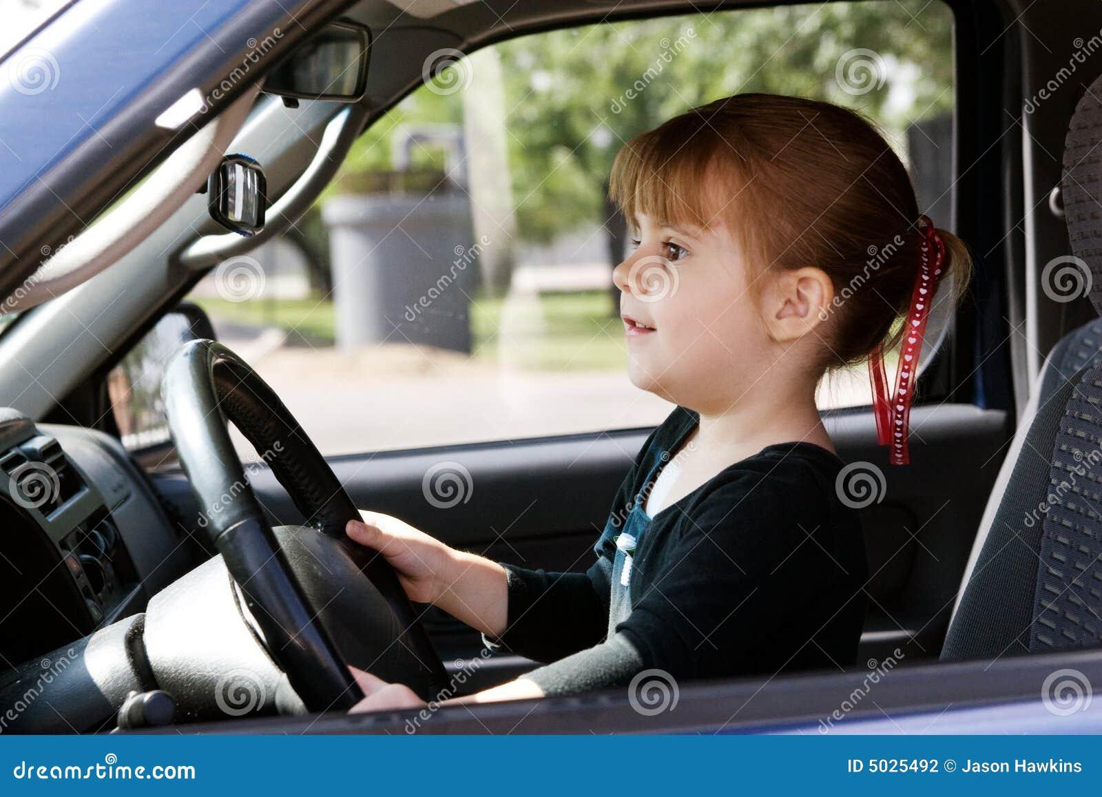 Drive Lyrics Cars: A Girl Driving A Car Stock Photography