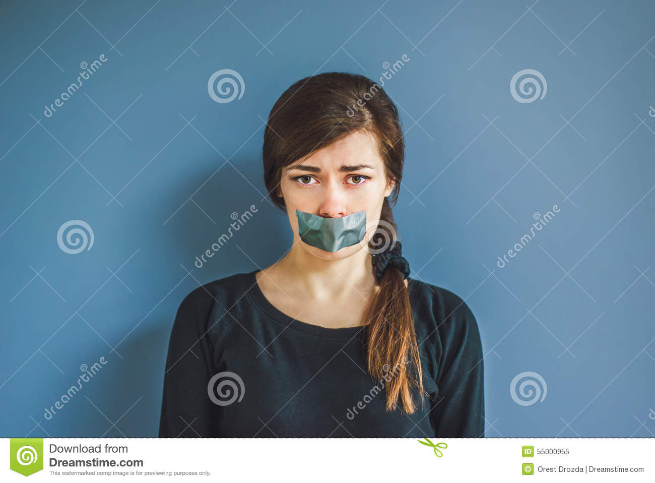 Girl with tape on her mouth