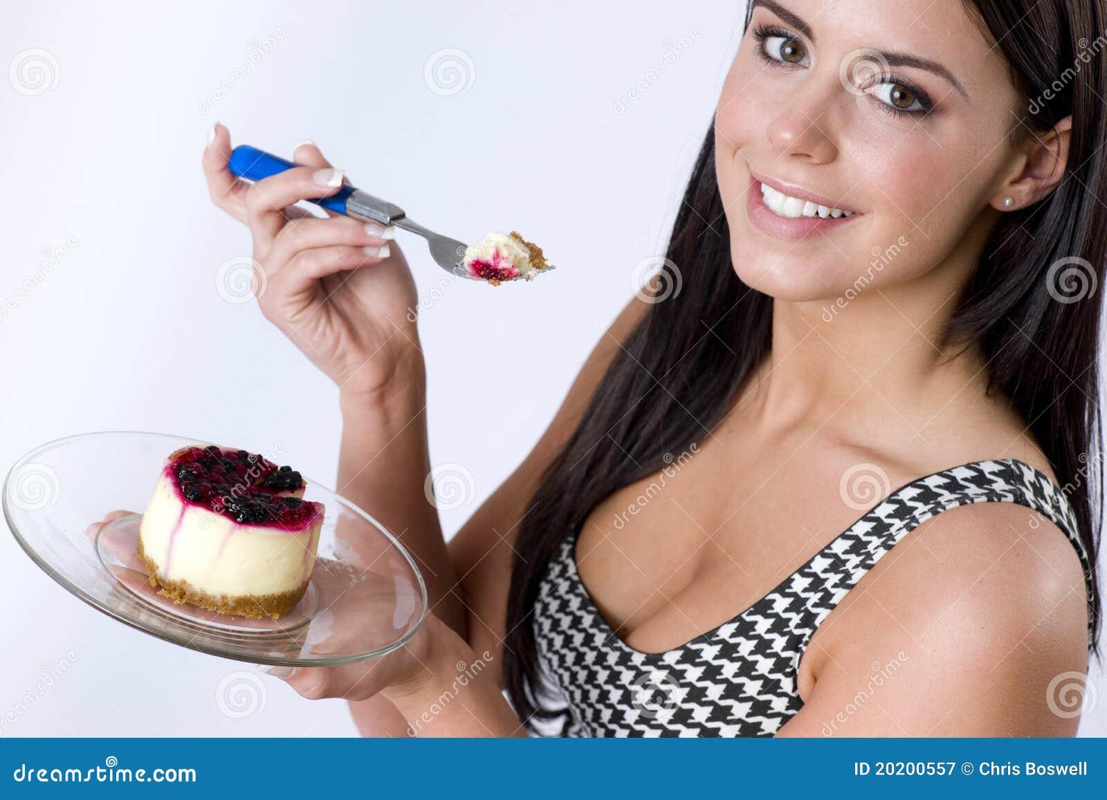 naked girl eating dessert
