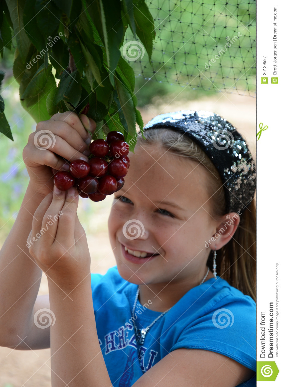 Girl Eating Cherries off of the Tree