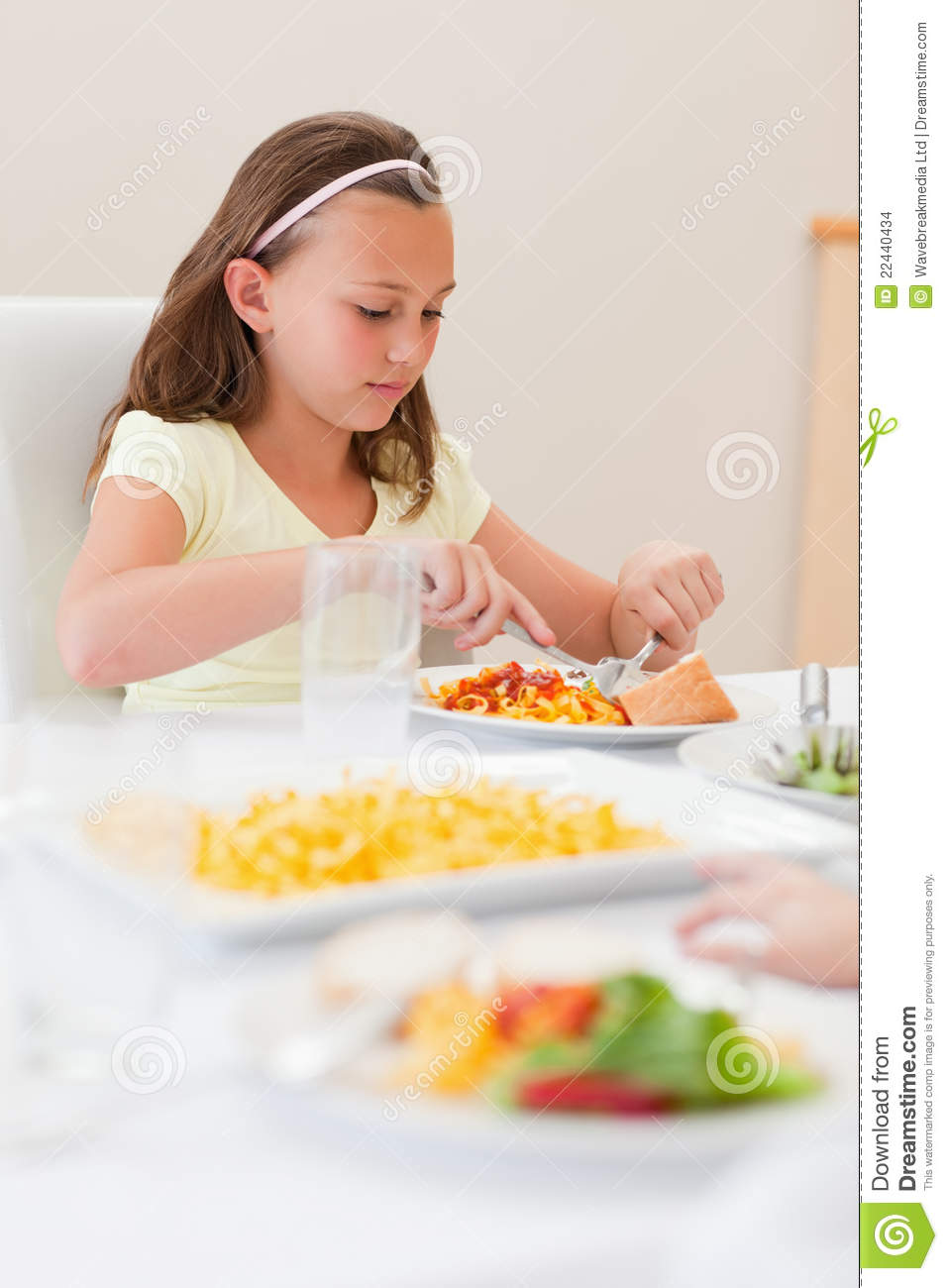 Girl eating at dinner table stock photo image 22440434 for Eating table