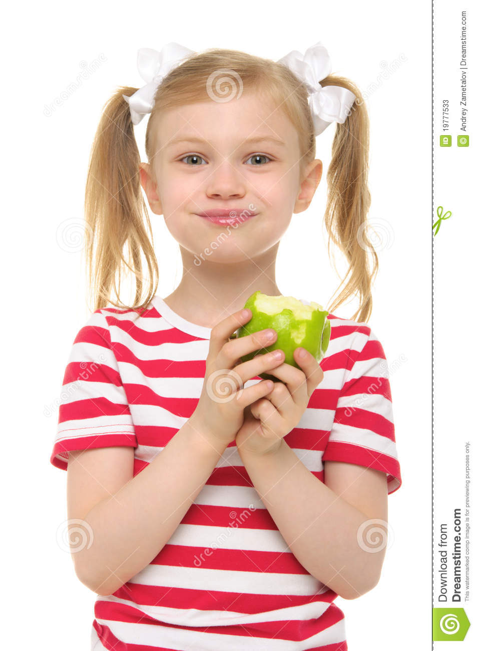 Girl eating green apple and smiling