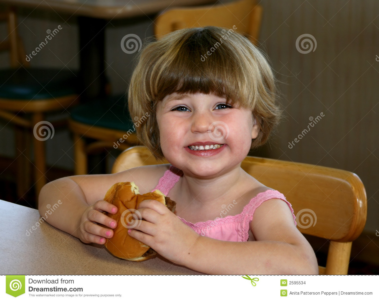 girl eating hamburger stock images image 2595534
