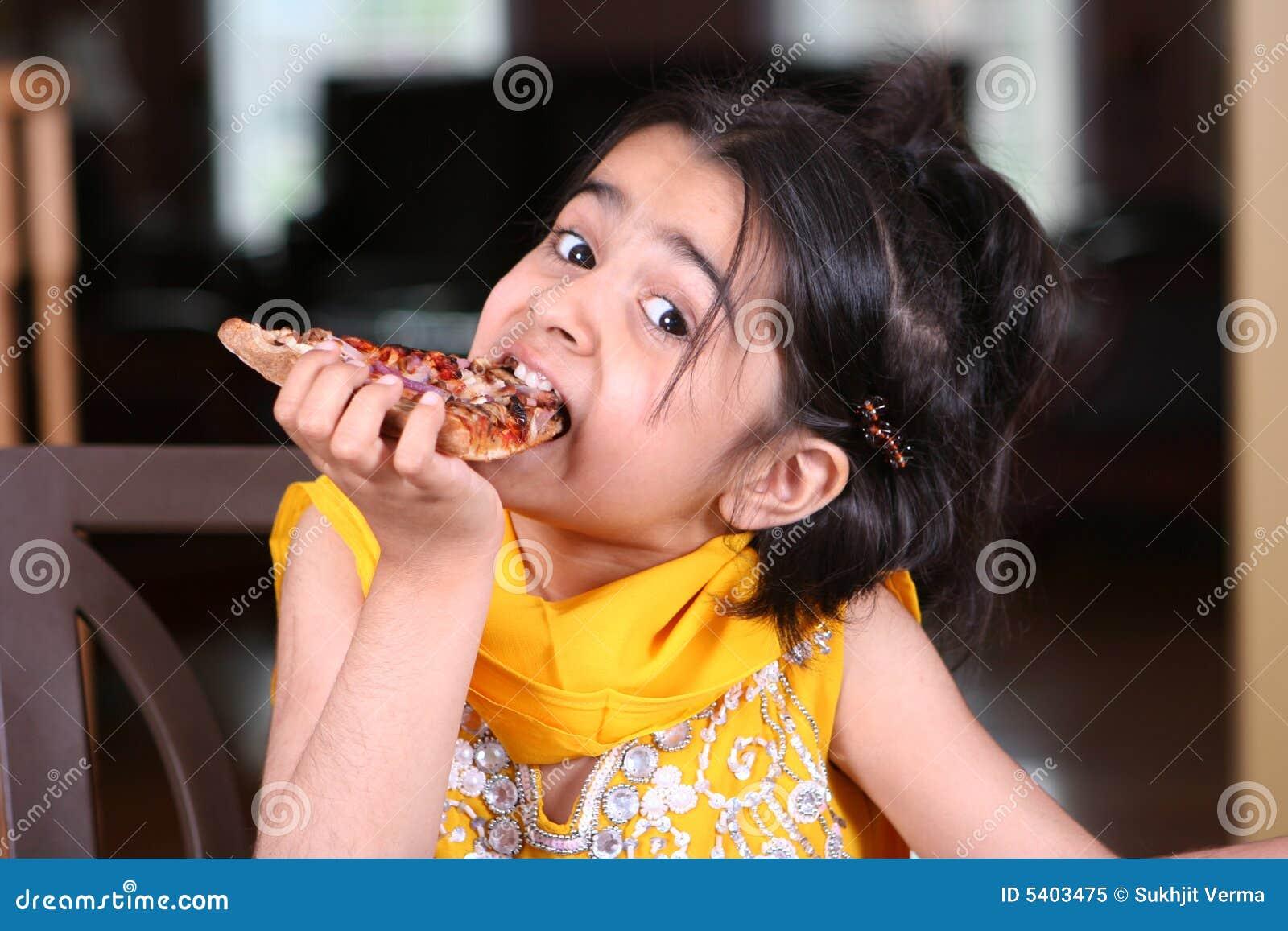 Girl eating pizza slice